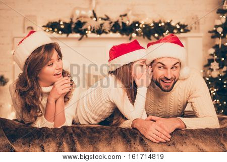 Little Girl Telling Secret To Her Dad. Christmas Concept