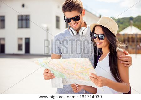 Portrait Of Happy Couple In Glasses With Cap Finding Way To Town