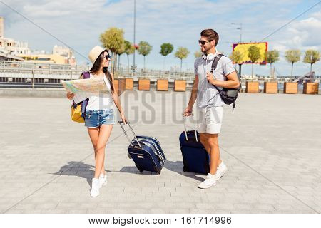 Two Lovers With Map And Valises Having Romantic Journey