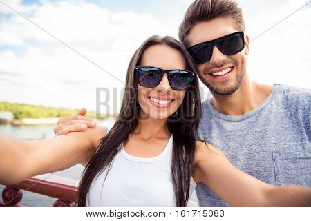 Selfie Of Happy Cute Lovers In Glasses Having Walk In City