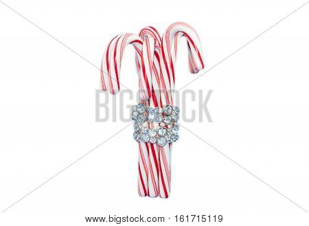 Christmas candy cane with diamond bracelet, Peppermint stick isolated on a white background.