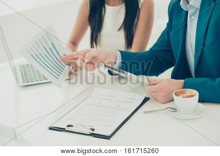 Close Up Of Businesswoman Showing Diagrama Of Financial Growth To Her Partner