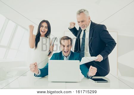 Happy Smiling Businesspeople Triumphing With Raised Fists