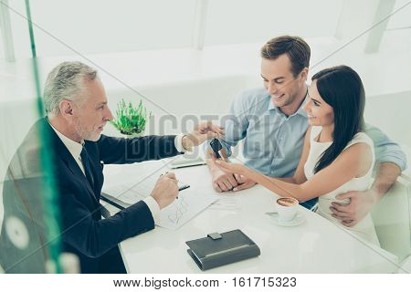 Real Estate Agent Working With Couple Of Customers And Giving Them Keys