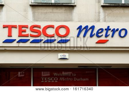 DURHAM, ENGLAND - JUNE 30, 2016: The exterior of an Tesco's Metro supermarket. Tesco's is one of the UK's leading supermarkets.