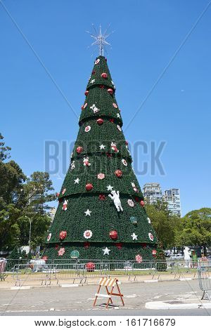 Sao Paulo Brazil - December 6 2016:Traditional Christmas tree in Ibirapuera being the 15th year of the attraction in the south zone of the city of Sao Paulo. With 35 meters of height 16 meters of diameter and a star of 8 meters in the top.