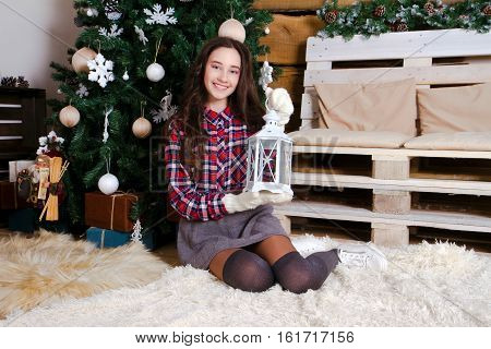 Pretty little girl with flashlight at christmas time.