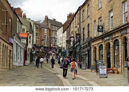 DURHAM, ENGLAND - JUNE 30 2016: Elvet Bridge historically known as Souter Peth. A Souter was a shoemaker so this street was the street of the cobblers. Leading to Saddler street.