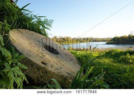 Vintage millstones at shore of Teletskoye Lake