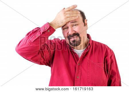 Distressed Middle Aged Man With Hand On Forehead