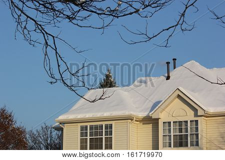 Fresh snow on town homes with beautiful despite modern architectural elements in Hoffman Estates, Illinois