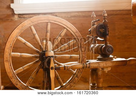 Traditional devices vintage tailoring equipment concept. Old fashioned wooden distaff spindle spinning wheel poster