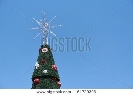 Sao Paulo Brazil - December 6 2016: Detail of traditional Christmas tree in Ibirapuera being the 15th year of the attraction in the south zone of the city of Sao Paulo. With 35 meters of height 16 meters of diameter and a star of 8 meters in the top.