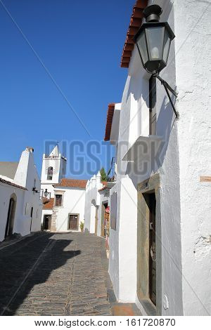 MONSARAZ, PORTUGAL - OCTOBER 11, 2016: A typical cobbled street with whitewashed houses