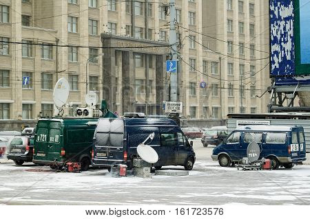Moscow, Russia - January 20, 2005: TV broadcast cars stand near State Duma in winter day