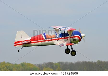 radio controlled  biplane model in the air