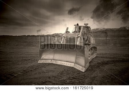 The bulldozer working in coal mines, old photo