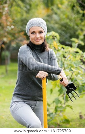 Woman having a break while working in the garden