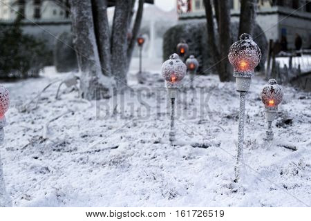 Walk of candlelights in the snow in chritsmas