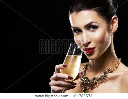 Beautiful Brunette With Dark Makeup Wearing Gold Jewellery