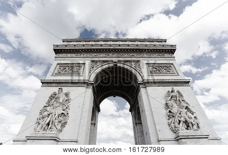 Triumphal arch. Paris. France. View Place Charles de Gaulle. Famous touristic architecture landmark in summer night. Napoleon victory monument. Symbol of french glory. World historical heritage. Toned