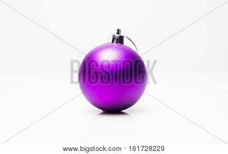 Purple Christmas ball isolated on white background.