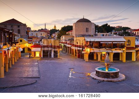 RHODES, GREECE - DECEMBER 05, 2016: Square in the old town of Rhodes at dusk on December 05, 2016.