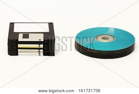On a white background are black floppy disks and CD / DVD disk