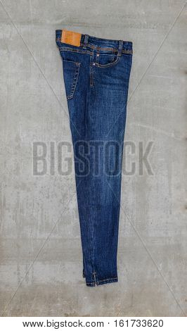 Side view blue jeans trouser isolated-gray background