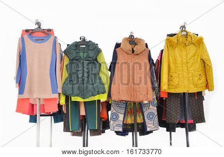 Form view Set of female dress with,coat isolated on hanging