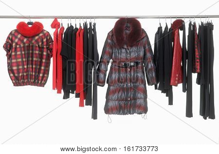 Female colorful clothes with coat, sundress, jeans isolated on hanging