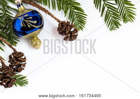 Evergreen Needles And Christmas Ornament On White