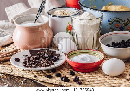 Ingredients of Homemade Oatmeal Cookies with Chocolate and Raisins