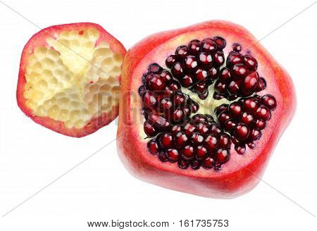 Ripe pomegranate fruit with a cut off top and intact grains, isolated on a white background. Top view