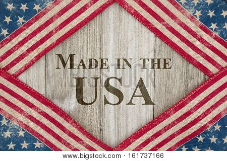 Made in America message USA patriotic old flag on a weathered wood background with text Made in the USA