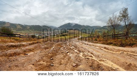 Muddy Ground After Rain In Mountains. Extreme Path Rural Dirt Road In The Hills