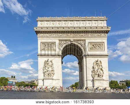 Paris France - July 24 2016: ChrissFroome of Team Sky wearing the Yellow Jersey passing by the Arch de Triomphe on Champs Elysees in Paris during the latest stage of Tour de France 2016.