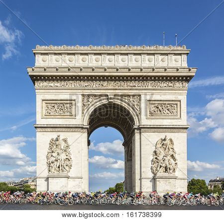 Paris France - July 24 2016: The peloton passing by the Arch de Triomphe on Champs Elysees in Paris during the latest stage of Tour de France 2016.