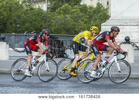 Paris France - July 24 2016: Chriss Froome of Team Sky wearing the Yellow Jersey Greg Van Avermaet and Damiano Caruso of BMC Team passing by the Arch de Triomphe on Champs Elysees in Paris during the latest stage of Tour de France 2016.