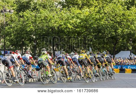 Paris France - July 24 2016: Team Sky with Froome in Yellow Jersey in the peloton passing by the Arch de Triomphe on Champs Elysees in Paris during the latest stage of Tour de France 2016.