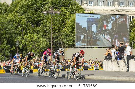 Paris France - July 24 2016: The breakaway passing by the Arch de Triomphe on Champs Elysees in Paris during the latest stage of Tour de France 2016.