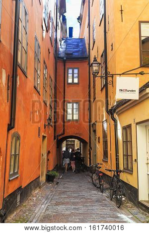 STOCKHOLM, SWEDEN - JUNE 27, 2016: This is one of the oldest medieval alleyways of Gamla Stan.