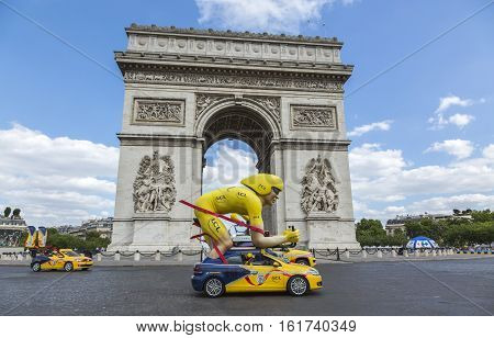 Paris France - July 24 2016: The speicific yellow cyclist mascot of LCL during the passing of The Publicity Caravan by the Arch de Triomphe on Champs Elysees in Paris during the latest stage of Tour de France 2016.