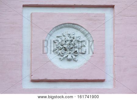 Bas-relief in a classical style on a wall. Architecture