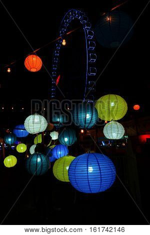 blurred colorful balloon paper lamps isolated on black background