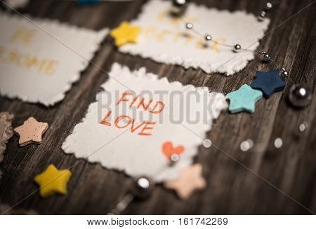 New Year's resolutions written on paper over wooden background