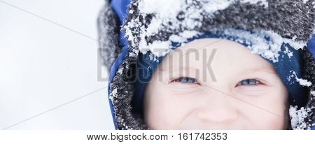 Happy Caucasian Child Playing In Snow