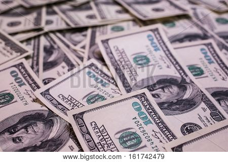 background of the money hundred dollar bills front side. background of dollars old hundred-dollar bill face millionaire businessman