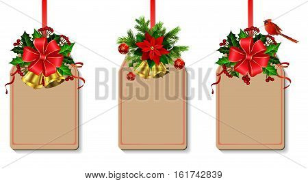 Christmas decoration with bow and holly and rowan berries golden bells cardinal bird decorated tag set with free space for your design