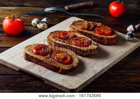 Bruschettas with Friaed Tomatoes and Condiment for Snack